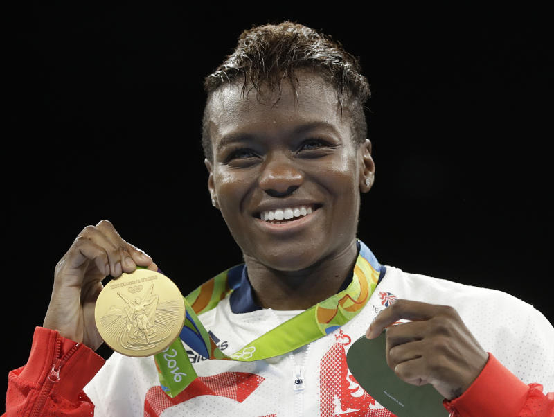Britain's Nicola Adams displays her gold medal for the women's flyweight 51-kg boxing at the 2016 Summer Olympics in Rio de Janeiro, Brazil, Saturday, Aug. 20, 2016. (AP Photo/Frank Franklin II)