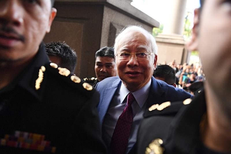 Najib Razak became the first former Malaysian prime minister to appear in court when he arrived to face graft charges related to the disappearance of billions of dollars of state funds during his nine-year rule (AFP Photo/MOHD RASFAN)
