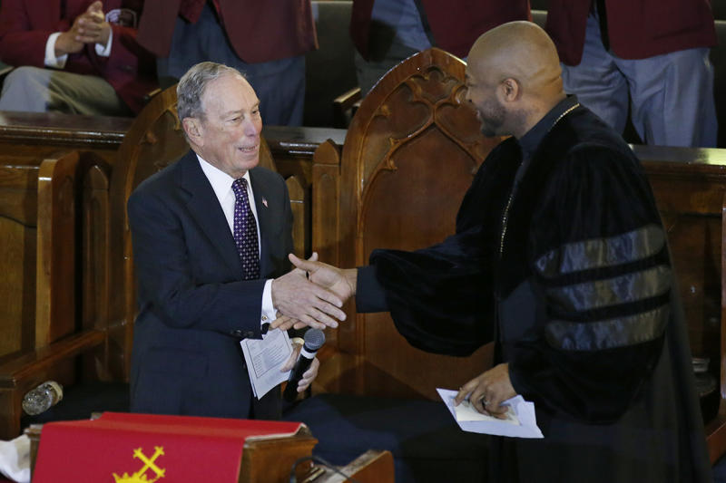 Democratic Presidential candidate Michael Bloomberg, left, greets the Rev. Robert Turner, right, during a service at the Vernon American Methodist Episcopal Church in Tulsa, Okla., Sunday, Jan. 19, 2020. (AP Photo/Sue Ogrocki)