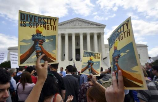 Demonstrators rallied outside the US Supreme Court as it decided to uphold President Donald Trump's controversial travel ban in a major victory for the Republican president