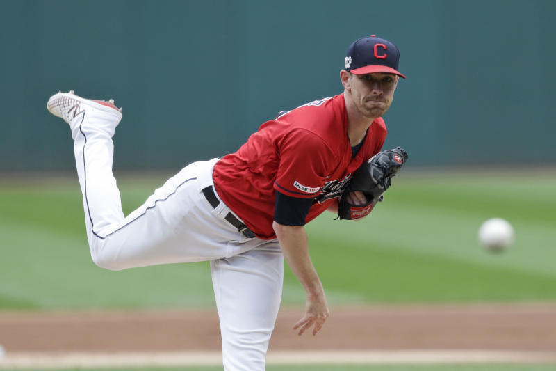Cleveland Indians starting pitcher Shane Bieber delivers in the first inning in a baseball game against the Minnesota Twins, Sunday, Sept. 15, 2019, in Cleveland. (AP Photo/Tony Dejak)