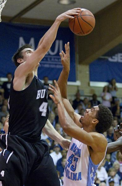 Butler center Andrew Smith (44) blocks the shot of North Carolina forward James Michael McAdoo (43) in the first half of an NCAA college basketball game in the Maui Invitational on Tuesday, Nov. 20, 2012, in Lahaina, Hawaii. (AP Photo/Eugene Tanner)