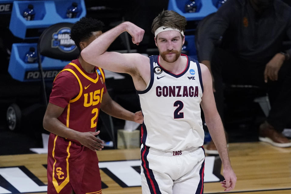 Gonzaga forward Drew Timme, right, celebrates in front of Southern California guard Tahj Eaddy, left, after making a basket during the first half of an Elite 8 game in the NCAA men's college basketball tournament at Lucas Oil Stadium, Tuesday, March 30, 2021, in Indianapolis. (AP Photo/Darron Cummings)