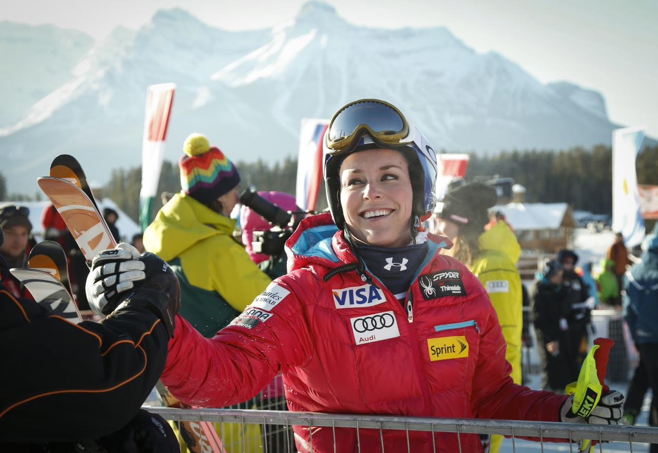 Lindsey Vonn, of the United States, celebrates in the finish area following her run at the women's World Cup downhill ski race in Lake Louise, Alberta, Friday, Dec. 6, 2013. (AP Photo/The Canadian Press, Jeff McIntosh)