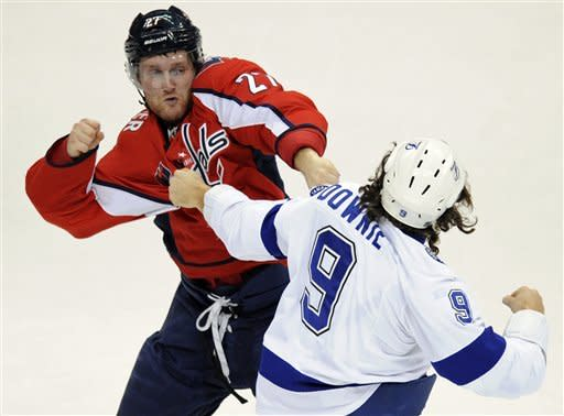 Washington Capitals defenseman Karl Alzner (27) fights with Tampa Bay Lightning right wing Steve Downie (9) during the second period of an NHL hockey game, Friday, Jan. 13, 2012, in Washington. (AP Photo/Nick Wass)