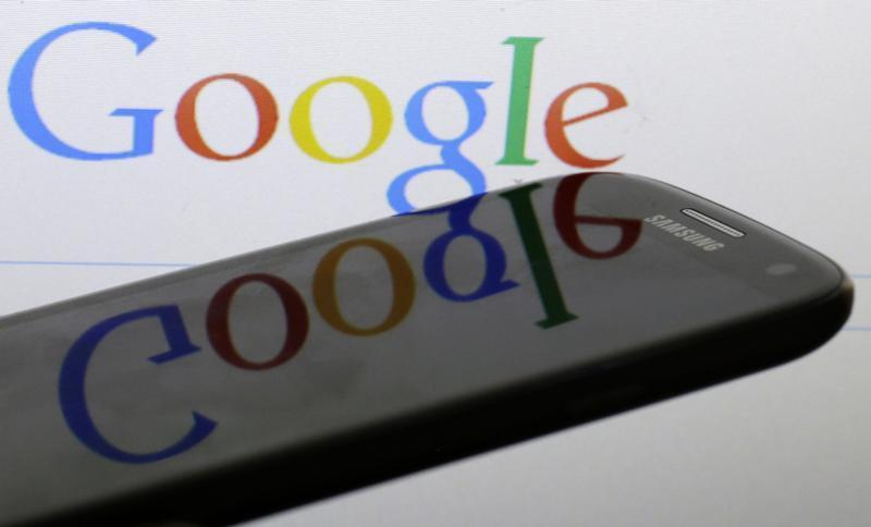 Photo illustration of Google logo is reflected on the screen of a Samsung Galaxy S4 smartphone