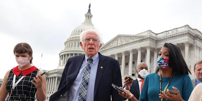 Independent Sen. Bernie Sanders of Vermont speaks to reporters as he leaves the US Capitol following a vote on October 05, 2021.