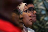 Victim's family member sheds a tear during the sixth annual remembrance event for the missing Malaysia Airlines flight MH370 in Putrajaya