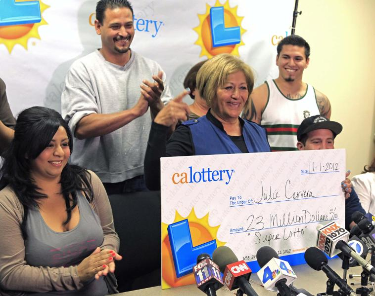 Julie Cervera, third from left, is surrounded by family members as she holds a $23-million dollar prize banner for the media in San Bernardino, Calif., Friday, Nov. 2, 2012. The 69-year-old California grandmother came forward to claim a $23-million lottery jackpot after the winning ticket languished in her car's glove compartment for months and almost expired. With 180 days to claim the prize, Cervera only had until Nov. 25 to cash in. (AP Photo/Damian Dovarganes)