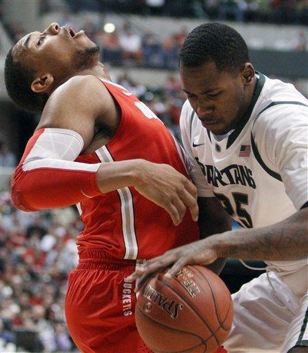 Michigan State center Derrick Nix, right, drives against Ohio State forward Jared Sullinger in the first half of an NCAA college basketball game in the final of the Big Ten Conference tournament in Indianapolis, Sunday, March 11, 2012. (AP Photo/Kiichiro Sato)