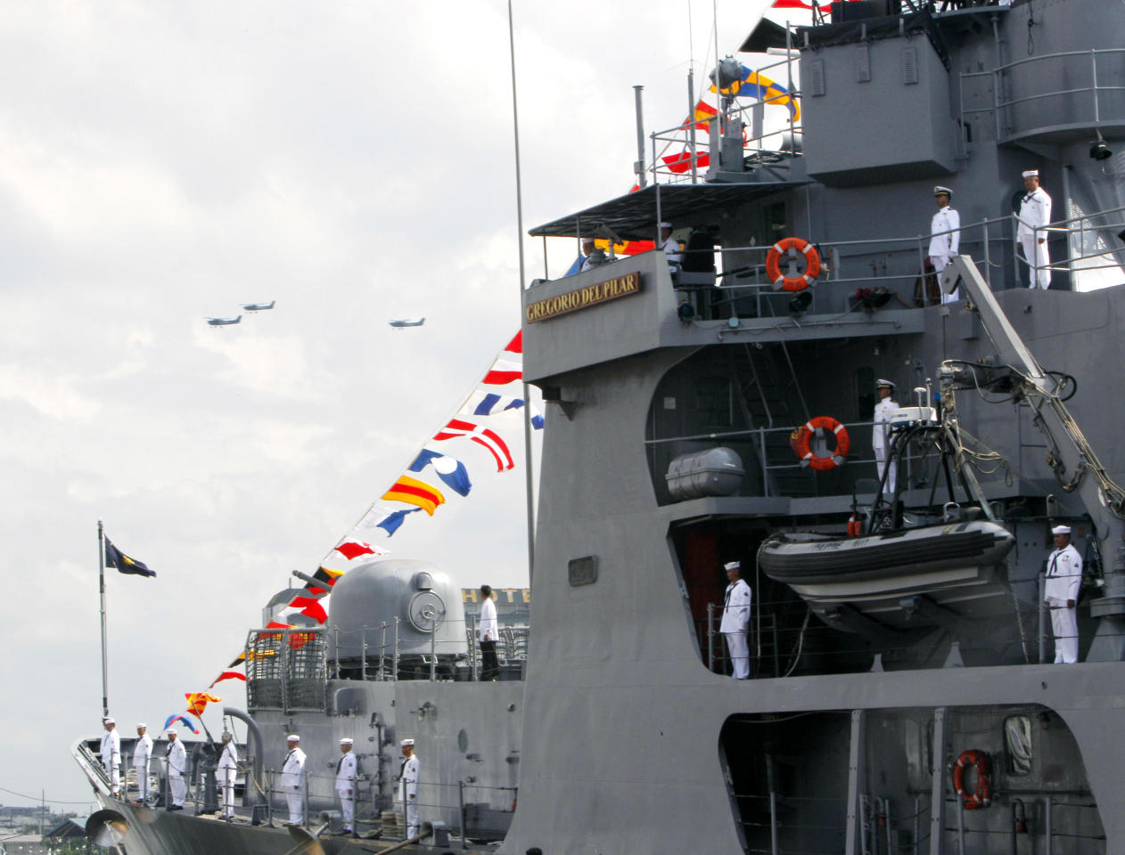 Philippine Navy small aircrafts fly over the country's newly-acquired Hamilton class warship BRP Gregorio Del Pilar (PF15) during commissioning ceremony Wednesday, Dec. 14, 2011 at the Manila South Harbor in Manila, Philippines. The country's biggest and most modern warship will be deployed to the volatile South China Sea, according to Philippine President Benigno Aquino III. (AP Photo/Bullit Marquez)