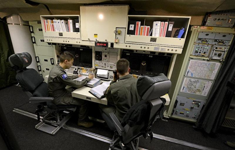 ** FOR TRANSMISSION AFTER 1AM, WEDNESDAY, JULY 9, 2014 **  In this photo taken June 24, 2014, 2nd Lt. Oliver Parsons, right, and 1st Lt. Andy Parthum check systems in the underground control room where they work a 24-hour shift at an ICBM launch control facility near Minot, N.D. The crew is responsible for controlling and launching the 10 nuclear-tipped Minuteman 3 missiles located in remote launch sites under their command. (AP Photo/Charlie Riedel)