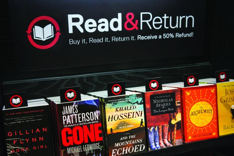 A Read & Return sign at an airport bookstore (Paradies Lagardere)