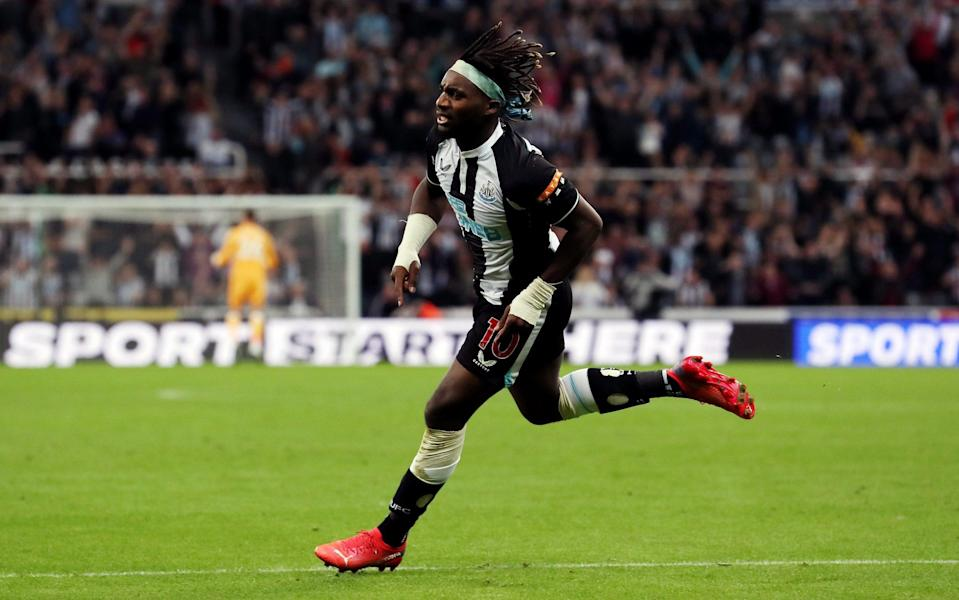 Allan Saint-Maximin of Newcastle United celebrates after scoring their team's first goal during the Premier League match between Newcastle United and Leeds United at St. James Park - Ian MacNicol/Getty Images