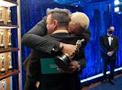 <p>Martin Desmond Roe and Travon Free hug tightly backstage after winning the Oscar for Live Action Short.</p>