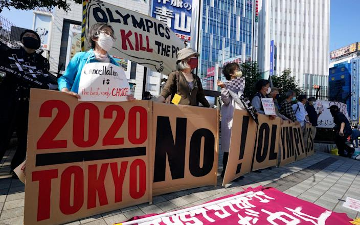 Protesters appeal to pedestrians during a demonstration against the Tokyo 2020 Olympic Games. After a three-day meeting the International Olympic Committee said the Olympic Games can be held this summer even if Tokyo is under a state of emergency due to the pandemic, but there is growing resistance in Japan - KIMIMASA MAYAMA/EPA-EFE/Shutterstock
