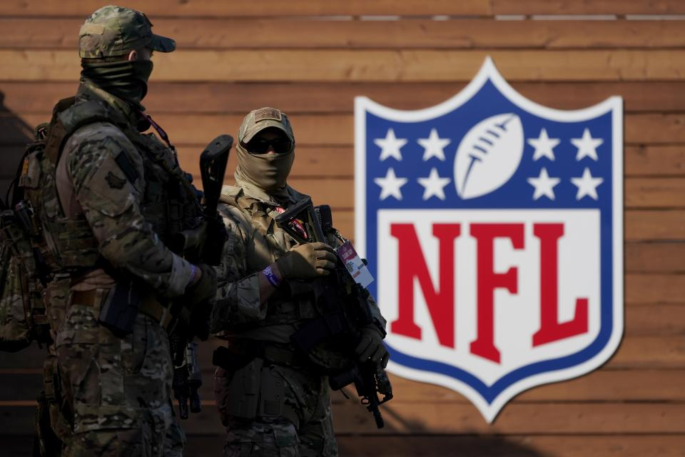 Sheriff's department officers work crowd control outside Raymond James Stadium before the NFL Super Bowl 55 football game between the Kansas City Chiefs and Tampa Bay Buccaneers, Sunday, Feb. 7, 2021, in Tampa, Fla. (AP Photo/Gregory Bull)
