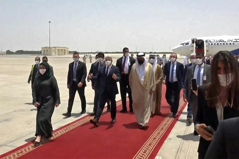 A grab from an AFPTV video shows Emirati officials welcoming Israeli alternate prime minister and Foreign Minister Yair Lapid upon arrival at Abu Dhabi airport, in the United Arab Emirates (UAE), on June 29, 2021