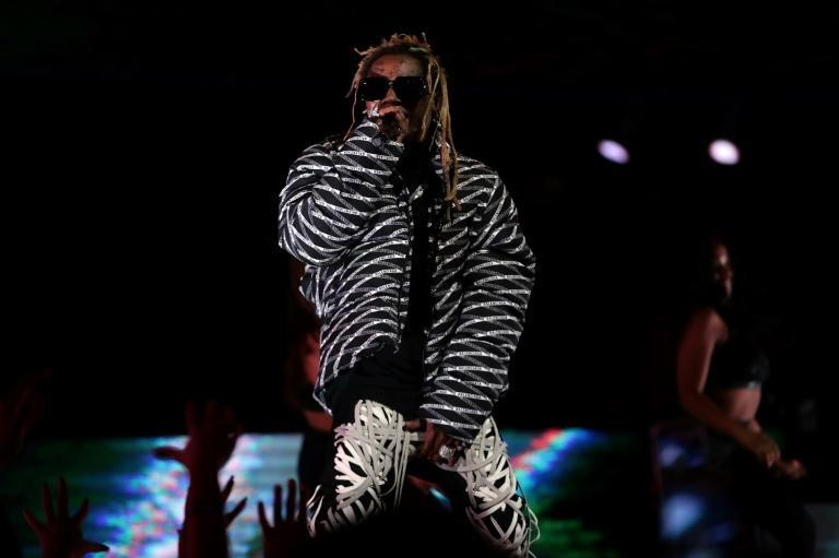 """Rapper Lil Wayne was pardoned for exhibiting """"generosity through commitment to a variety of charities, including donations to research hospitals and a host of foodbanks"""""""