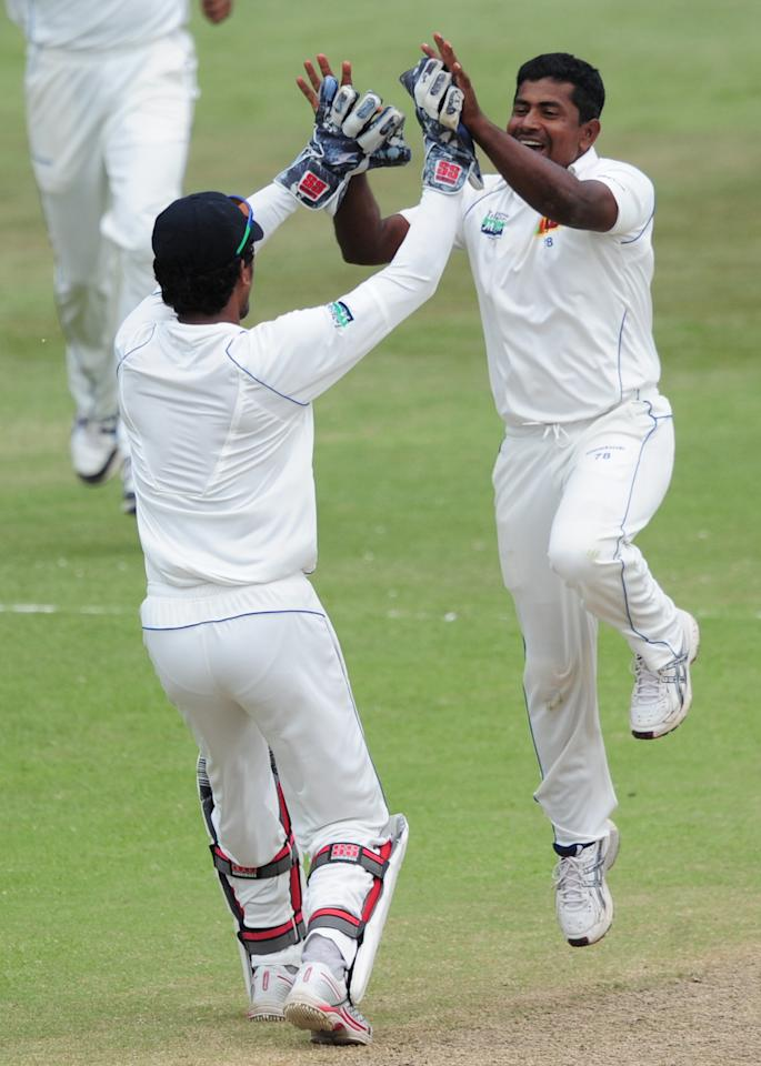 Sri Lanka's Dinesh Chandimal, left, celebrates with fellow team member Rangana Herath after taking the wicket of South Africa's Jacques Kallis for a second duck during their second five-day cricket test match in Durban, South Africa, Thursday, Dec. 29, 2011. (AP Photo)