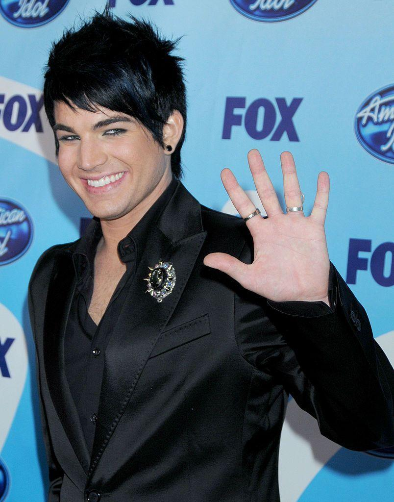 """<p>After finishing as the runner-up on the eighth season of <em>American Idol,</em> Adam Lambert collaborated with Queen as the lead vocalist and has toured worldwide with the band since 2014. Most recently, his voice can be heard in <em>Playmobil: The Movie </em>and he made a cameo in Taylor Swift's """"You Need to Calm Down"""" music video.</p>"""