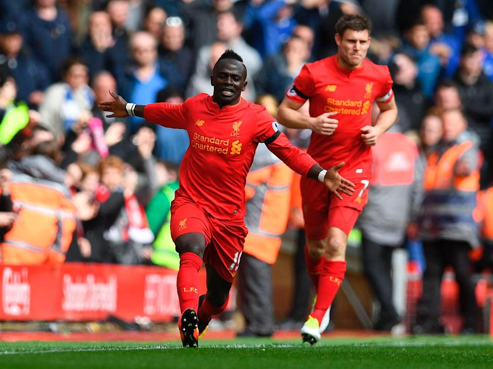 Sadio Mane celebrates scoring the opening goal for Liverpool: Getty