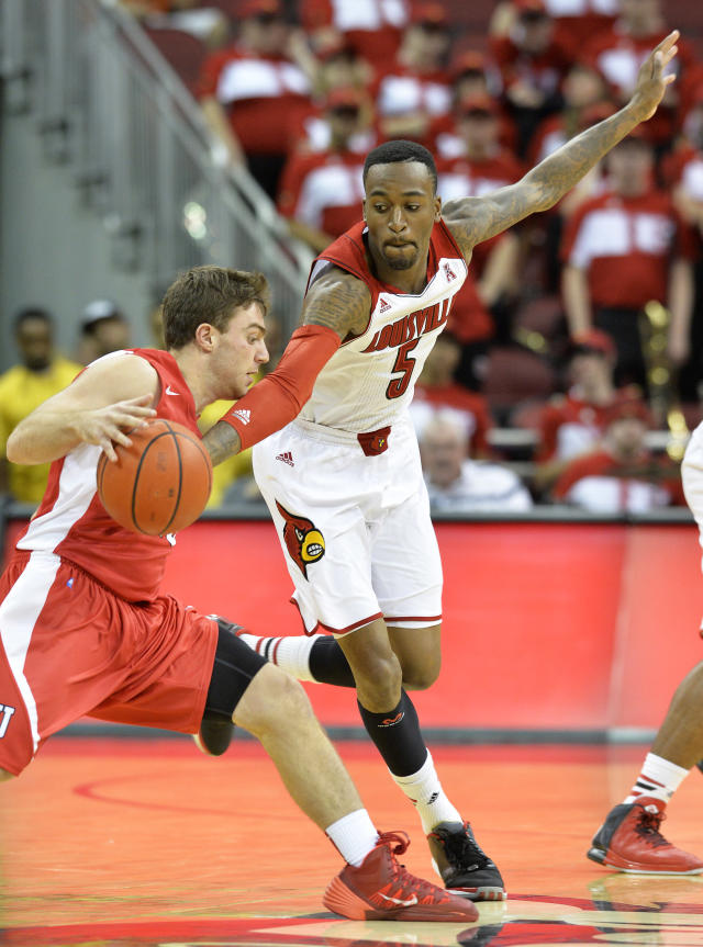 Louisville's Kevin Ware, right, attempts to knock the ball away from Cornell's JoJo Fallas during the second half of an NCAA college basketball game on Friday, Nov. 15, 2013, in Louisville, Ky. Louisville defeated Cornell 99-54. (AP Photo/Timothy D. Easley)