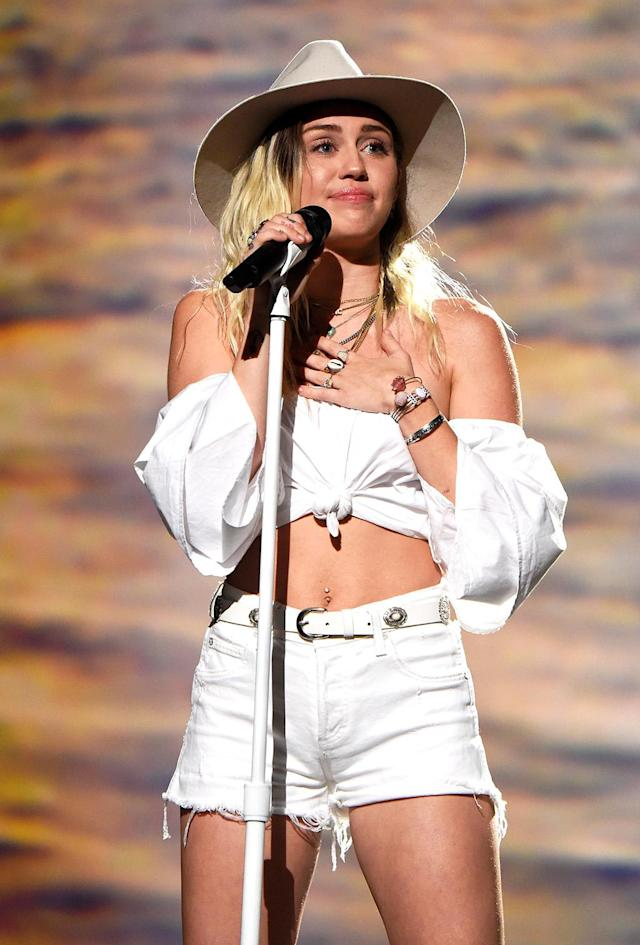 <p>Miley Cyrus performs onstage during the 2017 Billboard Music Awards at T-Mobile Arena on May 21, 2017 in Las Vegas, Nevada. (Photo by Kevin Mazur/BBMA2017/Getty Images for dcp) </p>
