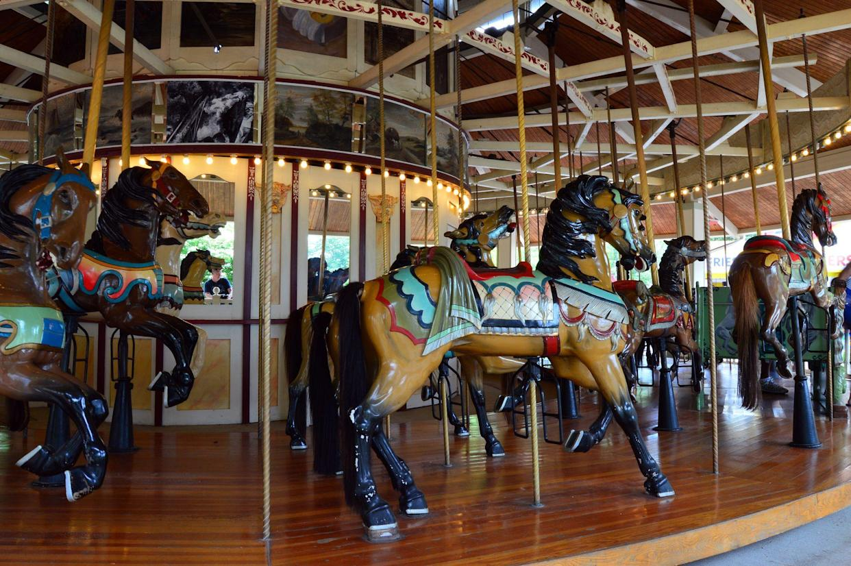 Bristol, CT, USA July 4, 2014 The Compounce Lake historic Carousel, built in 1890, awaits its next group of riders in Bristol, Connecticut