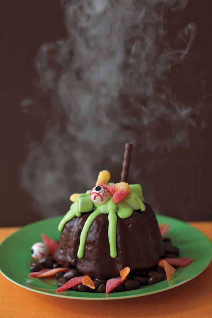 """<p>Time to get crafty with these petite pumpkin bundt cakes. Dipped in chocolate and topped with candy decor, bite into the taste of sweet cinnamon, Raisinets, and walnuts.</p><p><strong><em><a href=""""https://www.womansday.com/food-recipes/food-drinks/recipes/a11039/mini-cauldrons-recipe-122469/"""" rel=""""nofollow noopener"""" target=""""_blank"""" data-ylk=""""slk:Get the Mini Cauldron Cakes recipe."""" class=""""link rapid-noclick-resp"""">Get the Mini Cauldron Cakes recipe. </a></em></strong></p>"""