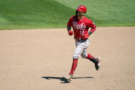 Cincinnati Reds' Tyler Naquin (12) rounds the bases on a three-run home run off Minnesota Twins' relief pitcher Hansel Robles in the ninth inning of a baseball game, Tuesday, June 22, 2021, in Minneapolis. (AP Photo/Jim Mone)
