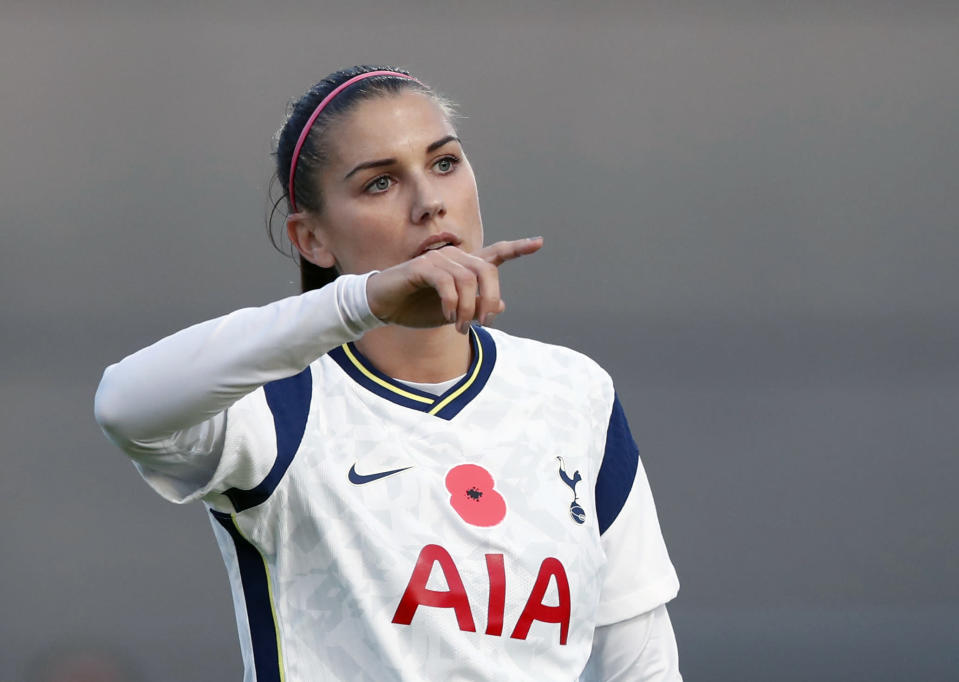 Tottenham Hotspur's Alex Morgan gestures to her teammates during the English Women's Super League soccer match between Tottenham Hotspur and Reading at the Hive stadium in London Saturday, Nov. 7, 2020. Morgan came on as a 69th minute substitute, the game ended in a 1-1 draw. (AP Photo/Alastair Grant)