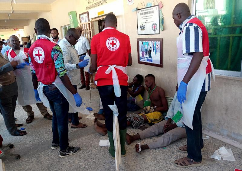 Red Cross workers attend to victims of Sunday's triple suicide bombing in Konduga (AFP Photo/Audu Ali MARTE)