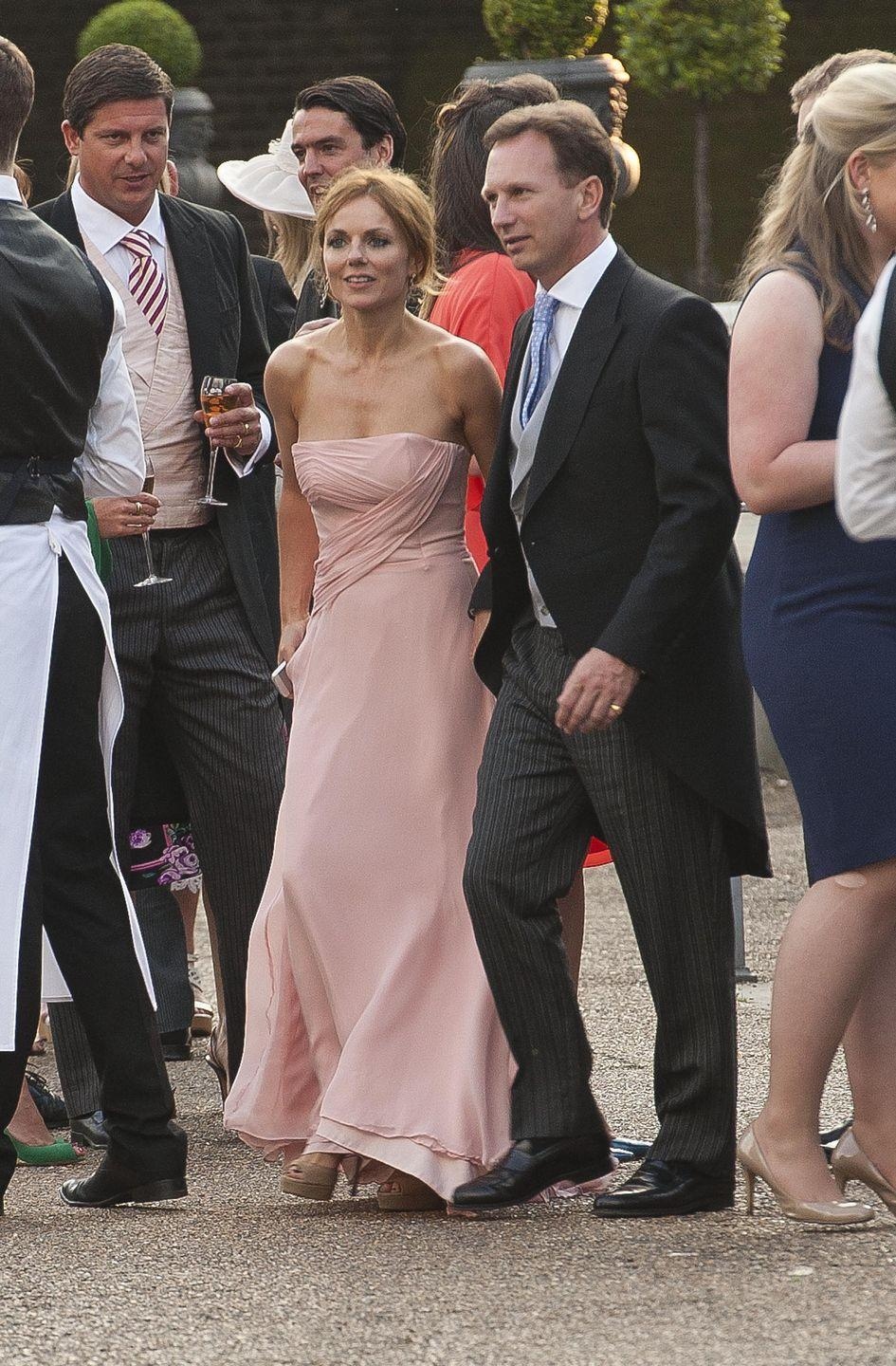 <p>Geri Halliwell selected a blush pink strapless dress for Poppy Delevingne's fancy wedding day.</p>