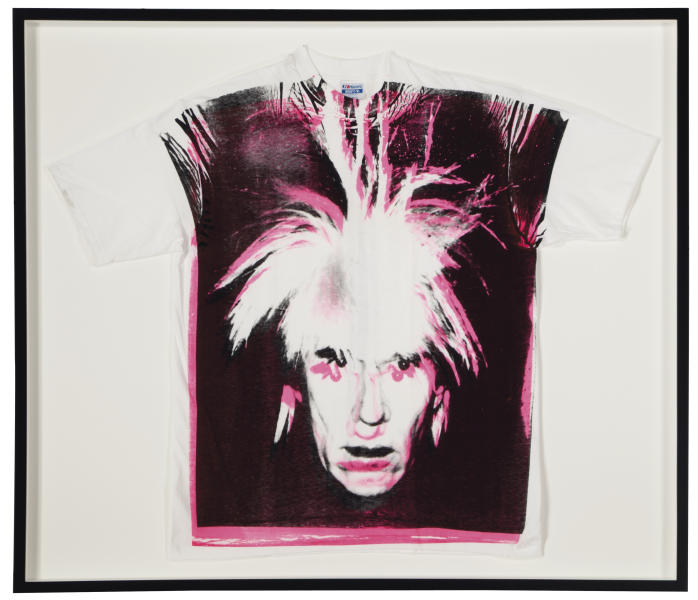 "This undated photo provided by Christies's auction house in New York shows Andy Warhol's ""Self-Portrait with Fright Wig screenprint on t-shirt,"" with a pre-auction estimate of $15,000 - $20,000. It is one of about 125 artworks being offered from Feb. 26 through March 5 in Christie's first online-only Warhol sale. The works can be previewed online prior to the sale. Bidders can browse, bid and receive instant updates by email or phone if another bid exceeds theirs. (AP Photo/Christie's)"