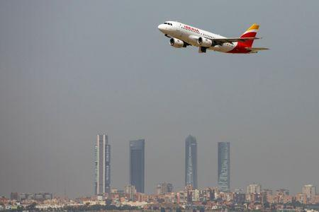 FILE PHOTO: An Iberia Airbus takes off from the Adolfo Suarez Madrid-Barajas airport, Madrid, Spain, August 8, 2018.  REUTERS/Paul Hanna