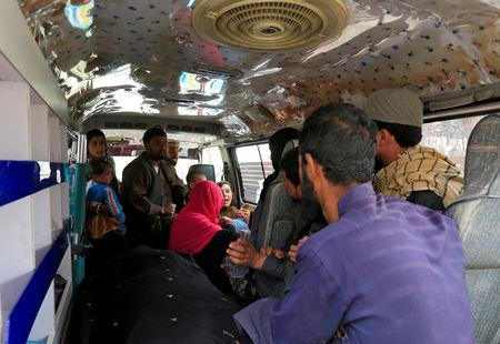 A family reacts inside an ambulance after they lost a family member after multiple explosions in Kabul, Afghanistan, March 21, 2019. REUTERS/Parwiz