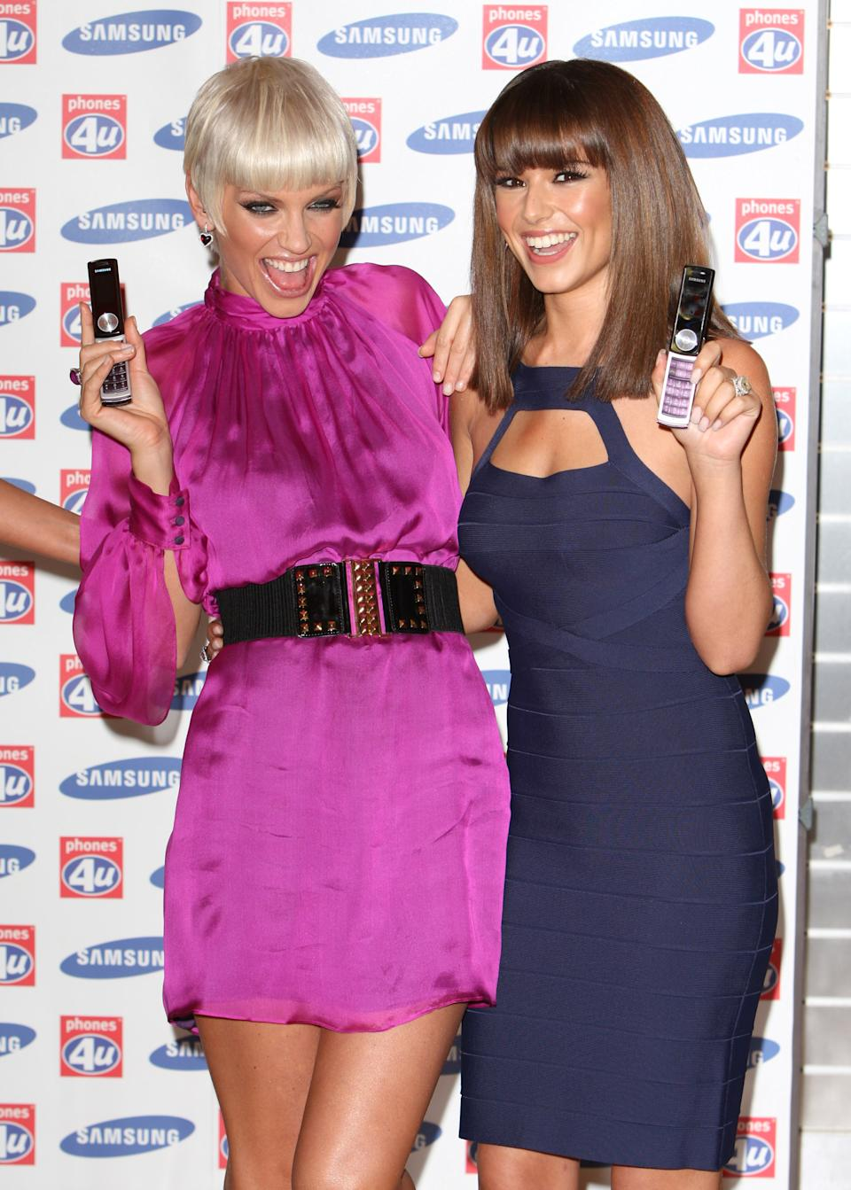 Sarah Harding and Cheryl Cole from Girls Aloud launches of the Samsung F210 Purple phone, at Phones 4U on Oxford Street, central London.