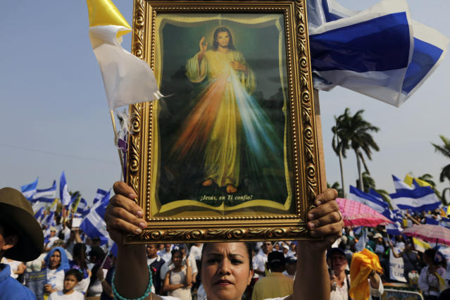 <p>Nicaraguan Catholic faithful take part in an open air mass, to demand the end of violence in their country, outside the Metropolitan Cathedral in Managua on April 28, 2018. University students at the forefront of anti-government unrest in Nicaragua on Saturday issued conditions for talks with the government of President Daniel Ortega. The demands followed a week of protests and clashes with police that left at least 43 people dead, according to a leading human rights group. (Photo: Inti Ocon/AFP/Getty Images) </p>