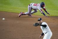 Washington Nationals' Yadiel Hernandez (29) advances past New York Yankees' Gleyber Torres to reach second base on a fielding error by Aaron Judge during the eighth inning of a baseball game Friday, May 7, 2021, in New York. (AP Photo/Frank Franklin II)