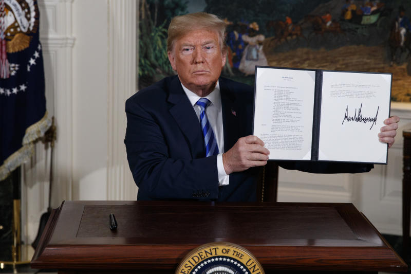 President Trump shows a signed Presidential Memorandum after delivering a statement on the Iran nuclear deal from the Diplomatic Reception Room of the White House on May 8, 2018. (Photo: Evan Vucci/AP)