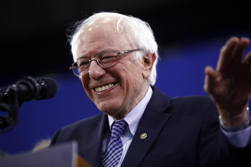Sen. Bernie Sanders smiles while addressing supporters at a rally in Manchester, N.H., on Tuesday. (AP Photo/Matt Rourke)