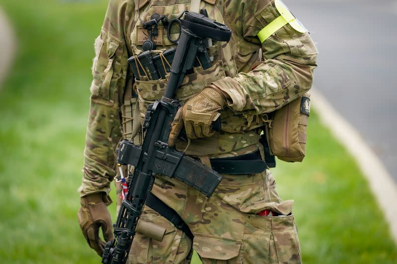 """FILE PHOTO: A member with the Three Percenters militia provides security for a """"Patriot Day 2nd Amendment Rally"""" in support of gun rights at the State Capitol in Frankfort"""