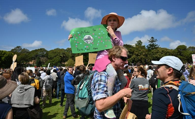 Children in Australia help kick off a historic global day of action seeing young people demand adults move faster to tackle climate change (AFP Photo/PETER PARKS)