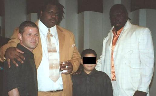 This photo was taken at Miami's team awards banquet following the 2002 season. From left to right are Nevin Shapiro, Vince Wilfork and Andrew Williams.