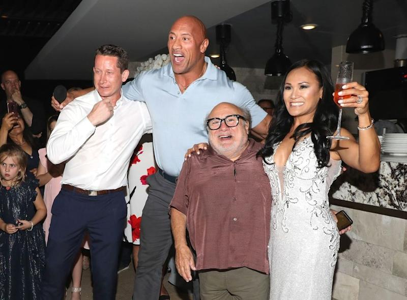 Dwayne Johnson (second from left) and Danny DeVito (second from right) crashed the wedding of Kristine and Will Abbot in Cabo San Lucas, Mexico on Nov. 23. | Victor Chavez/Getty Images