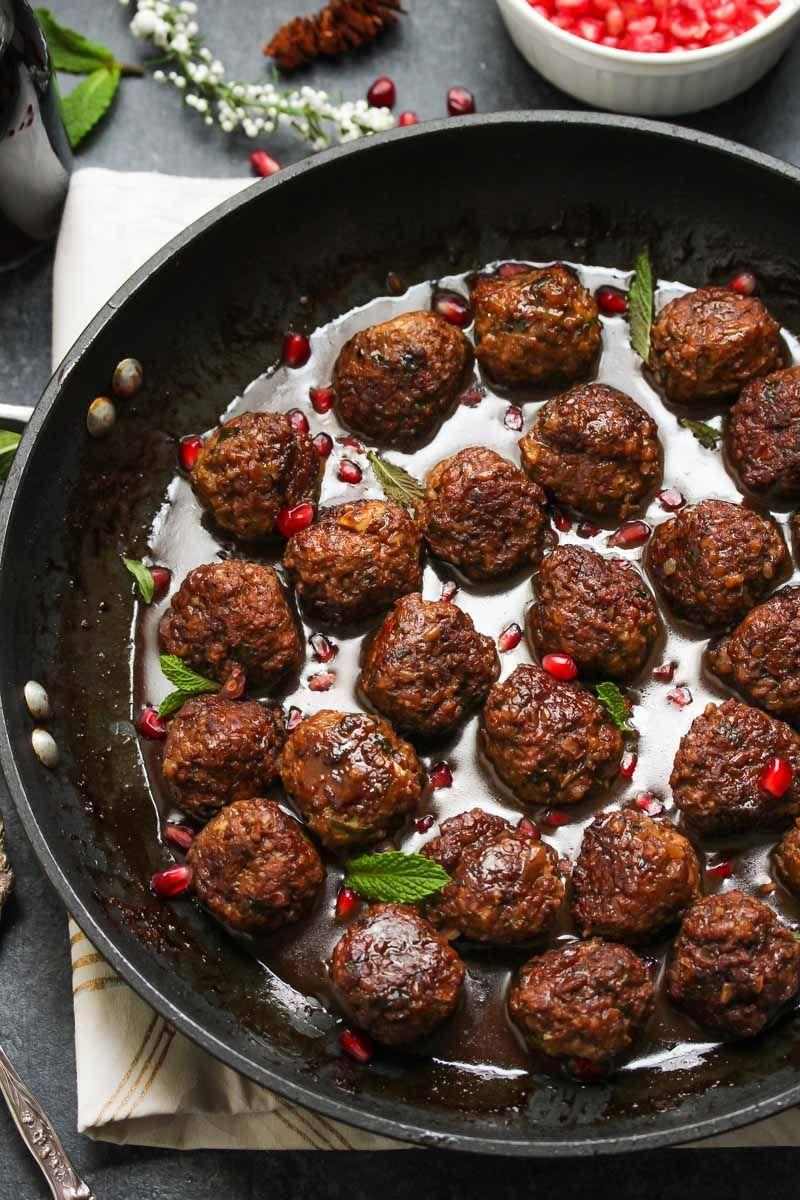 "<p>Give mini meatballs a nutrition (and flavor!) boost with whole grain bulgur, herbs, and spices, all tossed in a luscious pomegranate balsamic sauce.</p><p><em><a href=""https://dishingouthealth.com/beef-bulgur-meatballs-pomegranate-sauce/"" rel=""nofollow noopener"" target=""_blank"" data-ylk=""slk:Get the recipe from Dishing Out Health »"" class=""link rapid-noclick-resp"">Get the recipe from Dishing Out Health »</a></em></p>"