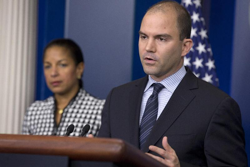 Ben Rhodes, deputy National Security Adviser for Strategic Communications and Speechwriting, right, accompanied by National Security Adviser Susan Rice, speaks about President Barack Obama's upcoming trip to Asia, Friday April 18, 2014 , at the White House briefing room in Washington. (AP Photo/Jacquelyn Martin)