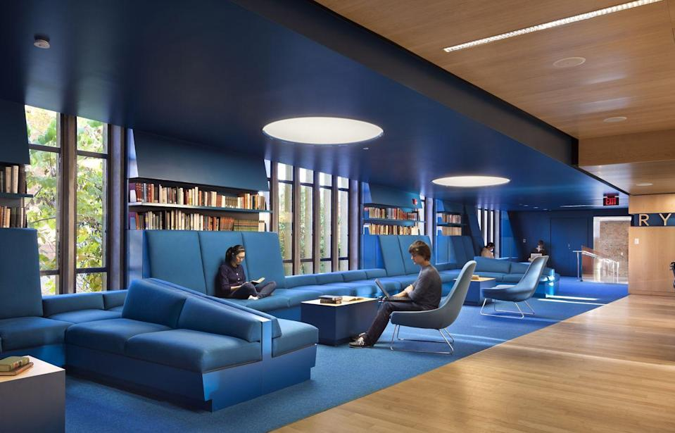 <p>This recently renovated 1960s-era <span>library</span> makes a major statement with bold blue that saturates parts of the space from floor to ceiling.<br></p>