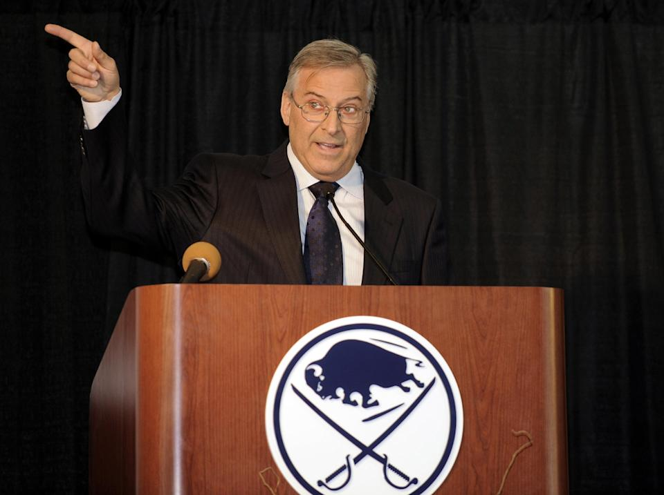 Buffalo Sabres' owner Terry Pegula, gestures toward the First Niagara Center and explains development plans during groundbreaking ceremonies before an NHL hockey game against the Philadelphia Flyers in Buffalo, N.Y., Saturday, April 13, 2013. (AP Photo/Gary Wiepert)